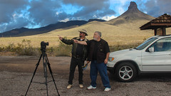 Clowing around while filming The American Landscape (Greg Nutt) Tags: az arizona bmw gregnutt tv x5 blue brown camera car donkey filming fun minimg moutains roadtrip smiles vacation white route66