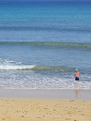 Porto Santo: Enjoying the moment... (Mr.Enjoy) Tags: ocean blue boy summer portrait orange white seascape reflection praia beach water hat stone relax fun happy mirror islands golden sand toddler marine warm paradise surf waves alone break child play hand flat crystal turquoise stripes sandy young aquamarine tshirt shades calm atlantic clean clear cap enjoy innocence vero shorts safe trunks moment splash now simple madeira throw timeless forget endless minions 2015 minion portosanto