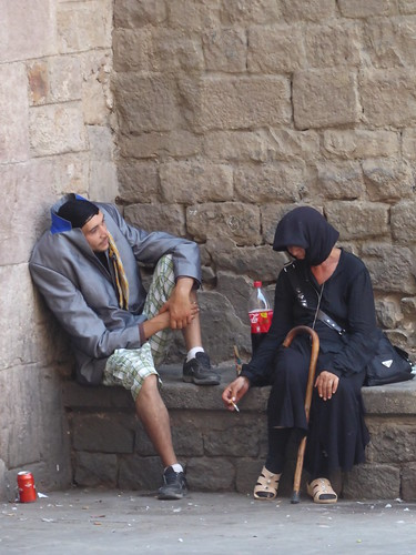 Smoke break for the headless man and crone in black - Barcelona (ashabot) Tags: spain streetscenes street streetlife crone beggar beggars people barcelona europe huskers travel urban urbanlife