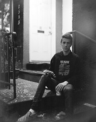 Brett, Stooping (christait) Tags: portrait blackandwhite bw canada vancouver iso3200 artist bc britishcolumbia ilfordhp5 painter stoop yvr graflex frontstep crowngraphic schneider210mmf56symmars brettbarmby rodinal1100stand3hrs
