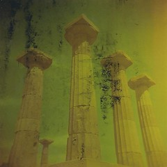 Athena's columns, buttered (sonofwalrus) Tags: film turkey holga lomo lomography columns middleeast scan buttered damaged pillars behramkale templeofathena hpc5380