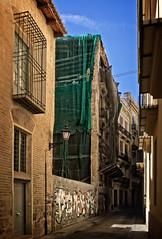 Inviting? For me — yes. (Tigra K) Tags: valència comunidadvalenciana spain es 2015 architecture city fabric lattice passage road ruin valencia window