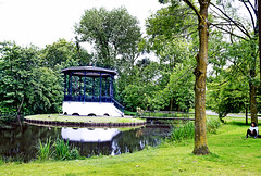 Emo Amsterdam (kirstiecat) Tags: emo emotional moody reflection gazebo vondelpark stranger woman female amsterdam dutch reflections europe netherlands water park summer landscape
