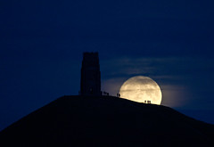 My Photo of the Year 2016 (Mukumbura) Tags: glastonbury supermoon fullmoon moonrise tor tower hill silhouettes people autumn november 2016 clouds somerset england lunar waxing gibbous mystical avalon perigee walking landmark astronomy craters seas mare littlepeople night outdoors photooftheyear best favourite happynewyear shot orb orbit satellite gettyimages