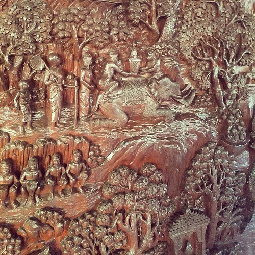 Crazy carved wall hanging at Doi Suthep Chiang Mai. Depicts the temple's founding and the white elephant legend shown here. From Wikipedia: According to legend, a monk named Sumanathera from the Sukhothai Kingdom had a dream. In this vision he was told to
