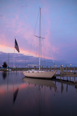 Alpena (DJ Wolfman) Tags: pink blue sunset sky color mi boats colorful sailing michigan olympus flags michiganfavorites sailboats lakehuron omd alpena northernmichigan em5ii