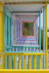 Squared rainbow, Clacton. (HartwellPhotography) Tags: england beach square coast seaside rainbow colours geometry veranda hut coastal essex clacton