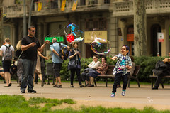 Child's play (Nils Croes) Tags: barcelona street urban playing canon fun outside happy spring soap child play 85mm happiness bubbles bubble 60d