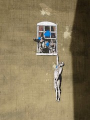 Banksy - naked man hanging from window