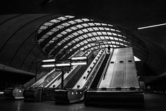 In transit (marktmcn) Tags: entrance canary wharf underground tube station exit way out escalators lights curved skylight norman foster architect london architecture blackandwhite monochrome d610 nikkor