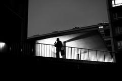 At the street window (pascalcolin1) Tags: paris13 nuit night lumière light ombre shadow homme man cigarette barriere barrier photoderue streetview urbanarte noiretblanc blackandwhite photopascalcolin
