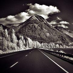Going Places (Mr Lunatic Fringe) Tags: bw mountain sky road clouds infrared 25 topf300 flickysbwphotography dantwenty bravo