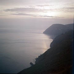 img316 (foundin_a_attic) Tags: 1970s glass slide 77 70s fashion cost sea hills cliffs view sunset