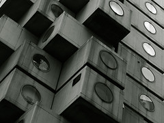 Nakagin Capsule Tower (Lil [Kristen Elsby]) Tags: windows japan architecture concrete tokyo office asia apartment modernism capsule dirty modular pollution porthole duotone  topf200 modernist shimbashi nakagin kishokurokawa shinbashi eastasia selfcontained kurokawa   nakagincapsuletower topv22222
