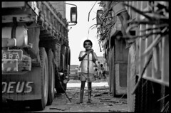 god and boy ( Tatiana Cardeal) Tags: boy brazil bw film 2004 topf25 brasil photojournalism documentary trucks tatianacardeal galleria invisibles brsil sugarcane alagoas actionagainstpoverty documentaire globalpoverty flickys excellenceinsets monocultura documentario magmag canasaobento