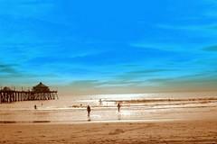 A Beachy Afternoon ({platinum}) Tags: huntingtonbeach california beach color surfers blue pier ocean sky sepia waves 2005