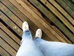 dilapidated wooden floor (adlaw) Tags: watershedarea cebu philippines canon powershot pro1 wooden floor feet nike kokoro brown wood denim psfk mycooljeans