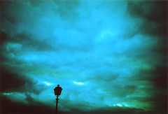 Sky and a Streetlamp (ale2000) Tags: street winter sky italy nature lamp clouds wow lost florence interestingness lca xpro die italia cross wind streetlamp apocalypse surreal natura best bathed crossprocessing when photowalk horror firenze poles process inverno flickrblog cloudjunkie lampione lookabove interestingness7 interestingness3 horrorvault i500 andwhenidie