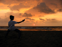 Sunrise Karate (Pandiyan) Tags: sea cloud brown sun beach topf25 topv111 sunrise topv333 rust moody martial karate kata itsongselection1 pandiyan chennai seashore silhoutte arun perfectingladolcevita itsongcanona20