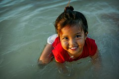frog at sunset (phitar) Tags: unicef travel bali 2004 water girl smile wow indonesia asia topv1111 topc75 topf200 lembogan phitar