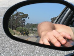 how i nearly killed myself (kidicarus222) Tags: road street selfportrait reflection me car santabarbara drive mirror automobile hand arm pavement fingers reflect vehicle sideviewmirror asphalt sideview goleta cathedraloaks