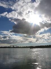 Into the light (Queen Of Light and Joy) Tags: sun light water river bridge sky rayoflight biking boardwalk evening twinsoo canada internationalbridge
