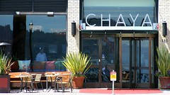 Chaya (Thomas Hawk) Tags: sanfrancisco california street city food plants usa plant man reflection lamp sign restaurant unitedstates chairs parking unitedstatesofamerica pillows pots eat tables chaya