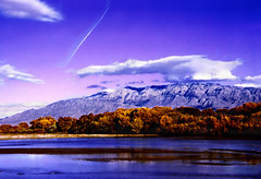 Falltime reflections on the Rio Grande (jimall) Tags: travel blue sunset sky copyright usa cloud mountain newmexico southwest reflection tree fall water wow river landscape gold landscapes yahoo interestingness google topv555 bravo flickr explorer albuquerque abq mostinteresting exploreinterestingness top10 nm sandia riogrande sandiamountains copyrighted neis jimallebach jimall jimbach wwwflickrcomphotosjimbachsets