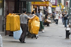 Yellow bags???? (ctownjb) Tags: new york city nyc yellow les bag asian chinatown manhattan side chinese east worker gothamist lower bundle shoulder burden carrying