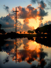Sunrise at Nombre de Dios Mission (eye2eye) Tags: 2005 sky reflection water clouds sunrise reflections river cross florida god crosses mission staugustine worshipimage
