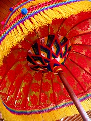 pajeng (Farl) Tags: pajeng payung umbrella brocade tassels yarn red ceremony religion faith hindu hinduism bali nusadua indonesia colors