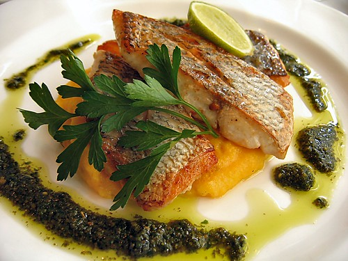 Grilled fish on polenta with pesto