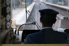 Rainy day train driver (Lil [Kristen Elsby]) Tags: topf25 japan topv2222 train japanese tokyo asia transport traintracks rainy trainstation transportation  traindriver keikyu eastasia keikyuline