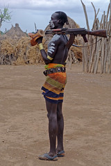 Karo warrior with AK-47 (CharlesFred) Tags: africa people orange man sexy male men expedition nature river paint gun masculine african south handsome tribal uomo rafting mens favourites tribes afrika remote ethiopia favourite myfavourites karo homme ak47 afrique 100000 uomini omo mannen eastafrica twohundred 041006 southomo omoriver charlesfred charle
