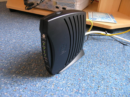 A Comcast cable modem sitting on a tabletop