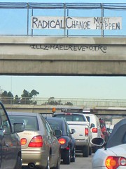 Radical change (Hayden Yates) Tags: city cars ford vw concrete los highway traffic angeles president overpass bumper jungle freeway bmw radical change interstate obama congestion lexus