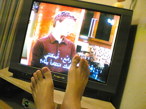Two feet watching TV