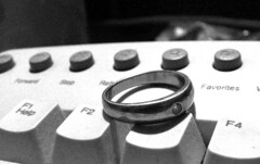 Wedding Ring in BW (alohadave) Tags: wedding white macro manipulated gold iso100 blackwhite keyboard fuji ring finepix fujifilm f28 6mm s3100 06ev 01sec
