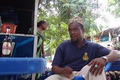 Christian because he has a Christian girlfriend (CharlesFred) Tags: africa travel sea fish port tanzania seaside fishing african daressalaam indianocean east fishmarket eastafrica tanzanian fishingport