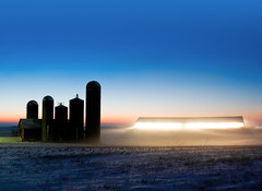 Alien Twilight (Todd Klassy) Tags: longexposure morning travel pink light sunset sky mist snow cold color ice field silhouette horizontal fog wisconsin barn rural sunrise landscape outdoors dawn twilight haze cattle dusk snowy farm horizon country alien farming shed january foggy earlymorning beautifullight surreal bluesky nobody nopeople ufo silo mysterious copyspace cloudless agriculture outerspace wi atnight futuristic dramaticlighting clearsky beltofvenus dairyfarm mounthoreb stockphotography rurallife agribusiness colorimage farmbuildings ruralscene nonurbanscene thebeltofvenus farmjournal ruralwisconsin wisconsinfarm winterinwisconsin wisconsinphotographer wisconsinlandscape mounthorebwisconsin toddklassy freestallbarn wisconsinlandscapephotographer