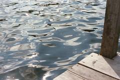 Dock on Lake Harriet (Mamluke) Tags: sun sunlight lake water minnesota see dock agua aqua eau wasser minneapolis lac harriet tageslicht sunlit acqua liquid  zonlicht leau lumiredusoleil minneapolisminnesota luzdelsol mamluke lucesolare