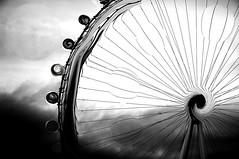 Alternate London (Gwynedd) Tags: light england sky blackandwhite distortion london eye wheel clouds photoshop 3d wheels surreal londoneye ferris fantasy rides sciencefiction pods