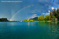 Rainbow over Lake Bled (Ian Middleton: Photography) Tags: travel summer vacation mist lake holiday storm mountains reflection building green tower history tourism church water beautiful architecture clouds religious island rainbow scenery europe european bell famous scenic eu tourist double architectural historic christian slovenia alpine touristy stunning bled former christianity popular yugoslavia attraction shimmering eec slovenian slovene gorenjska slavic