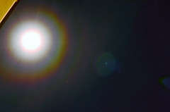 Lunar Corona_w/ increased levels (revised) (northern_nights) Tags: 100f10f lunarcorona fullmoon iridescence stars sky overexposure cheyenne wyoming nikond7000 nikkor35mmf14 lensflare colorful 100v10f atmosphericoptics