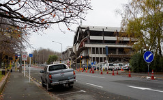 Soon be Cleared (Jocey K) Tags: road street trees newzealand christchurch sky people signs building cars architecture clouds concrete outdoors autumncolours cbd rubble roadcones christchurchpolicestationdemolition