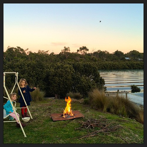 162/365 • celebrating the #wintersolstice with GF damper on sticks at sunset. New beginnings... • #162_2015 #7yo #4yo #boatyard #fire #solstice #Winter2015 #water