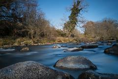 Metallic River (Amy Louise Moore) Tags: blue trees sky rural river countryside stream long exposure fuji stones metallic steel rangefinder boulders devon fujifilm milky dartmoor 18mm xf haytor mirrorless xpro1