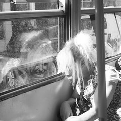 But what's she looking at? (Salle-Ann) Tags: street urban bw reflection lady blackwhite tram melbourne