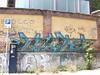 151 (en-ri) Tags: muro wall writing one graffiti giallo arrow nero novara neks indaco
