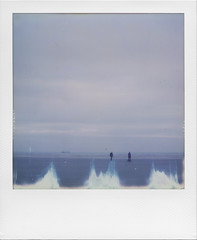 With reveries of days gone by (ale2000) Tags: polaroid impossible instant sx70 instantphotography analog analogue winter wintertime blue sight sea seaside shore water acqua ocean nordzee maredelnord flaws flawed sky cielo clouds cloudy nuvole nubi nuvoloso framed frame square